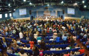 Diverse group of people congregate in a faith church