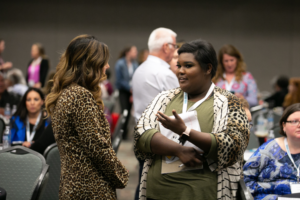 Two women in discussion during the 2019 Robert Lee Sutherland Seminar