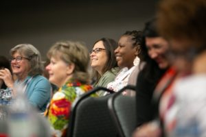 A group of women watching a presentation during the 2019 Robert Lee Sutherland Seminar