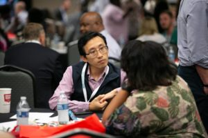 A a man in discussion with other attendees during the 2019 Robert Lee Sutherland Seminar