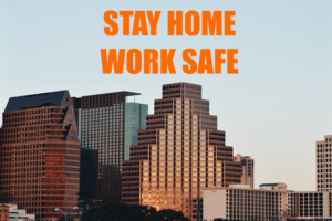"A photo of a skyline with the words ""stay home, work safe"" on it"
