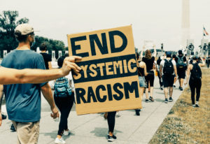 A sign that says end systemic racism